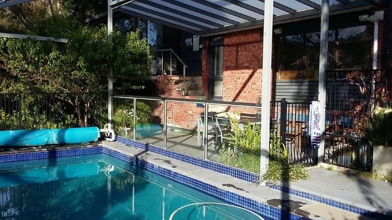 New swimming pool and Alfresco area with raked opal polycarbonate roof: Adelaide Architect Grant Lucas