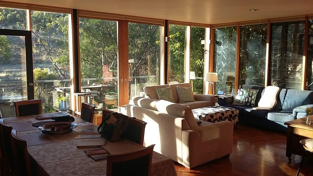 New balcony and Living Room with full height glass windows by Adelaide Architect Grant Lucas