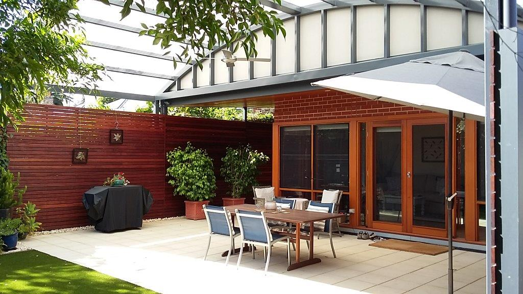 Family room Extension and and curved twinwall polycarbonate verandah to Red Brick and stone Cottage Kent Town SA: External