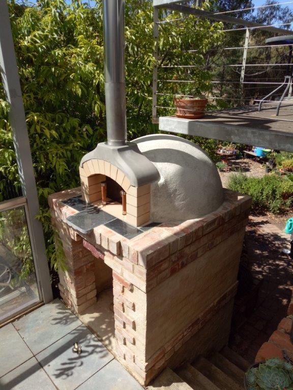 Pizza oven under balcony
