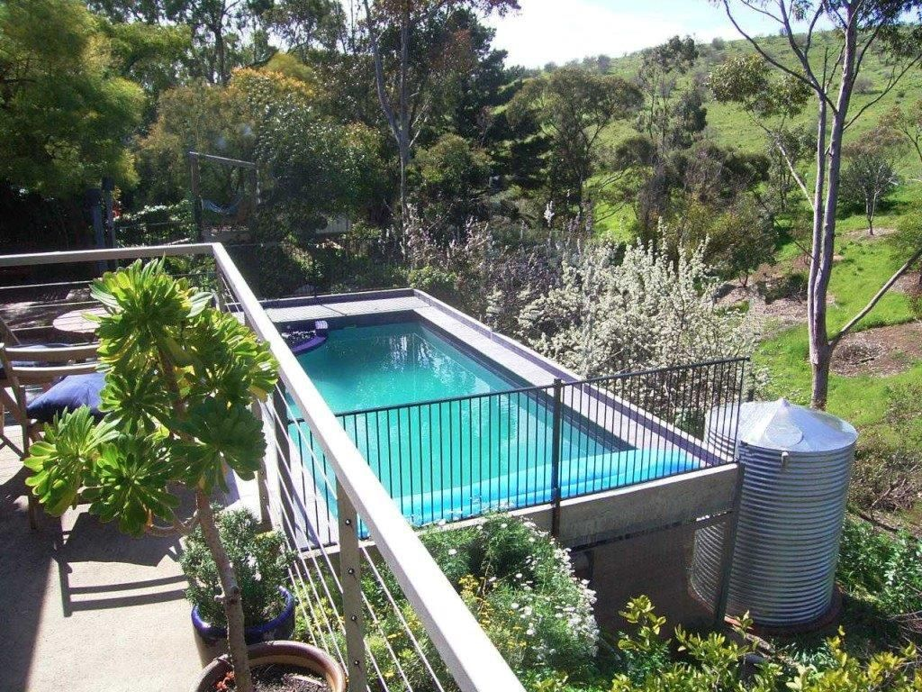 Elevated Concrete Swimming pool Pool and Balcony on a steep hillside by Adelaide Residential Architect Grant Lucas