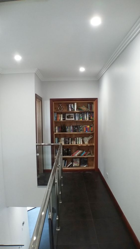 Energy Efficient House at Taperoo: Custom Joinery: Bookcase to hidden room